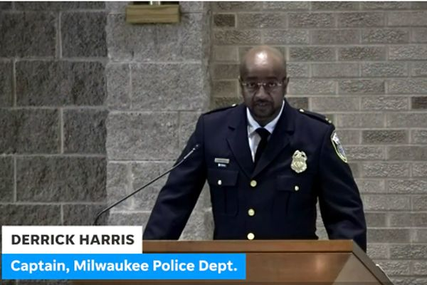 """Captain Derrick Harris spoke at the memorial service for Officer Thomas Kline on Monday—who died by suicide in early September—saying, """"I will grieve his loss forever."""" - Screen grab of news report."""