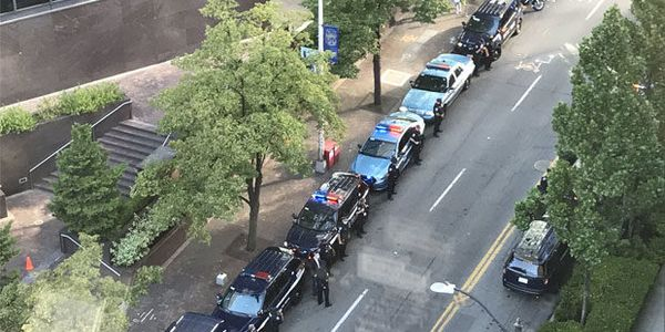Officers and civilians line a street to honor departing Seattle Police Chief Carmen Best....