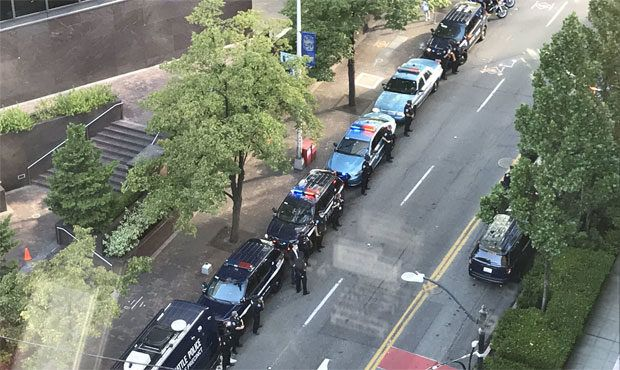 Officers and civilians line a street to honor departing Seattle Police Chief Carmen Best. (Photo: Carmen Best/Twitter) -