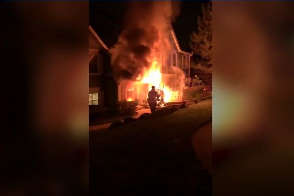 An officer with the Lisle (IL) Police Department is being lauded as a hero in the community after he rushed into a burning building, remerging into the safety of the outside with a 14-year-old boy in his arms. - Screen grab of news report.