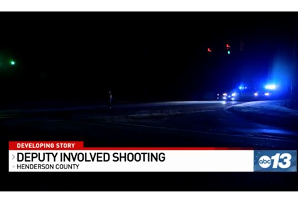 A deputy with the Henderson County (NC) Sheriff's Office is listed in critical condition in a local hospital following a gunfight in which the assailant was fatally shot on Wednesday night. - Screen grab of news report.