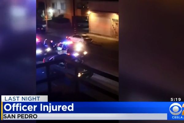 """An officer with the Los Angeles Police Department was attacked inside a division station facility by a suspect who allegedly grabbed the officer's sidearm and began """"pistol whipping"""" him with it. - Screen grab of news report."""
