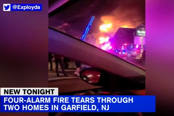 The Garfield (NJ) Police Department has called out for help for an officer who lost her home, her car, and all of her material possessions when a fire engulfed two structures on Saturday night. - Screen grab of news report.