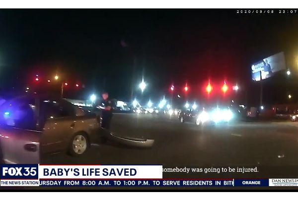 Officer Curtis Neraasen will receive an award from the Orlando Health Arnold Palmer Hospital where the one-year-old—aptly named Miracle—is recovering from injuries sustained in the crash. - Screen grab of news report.