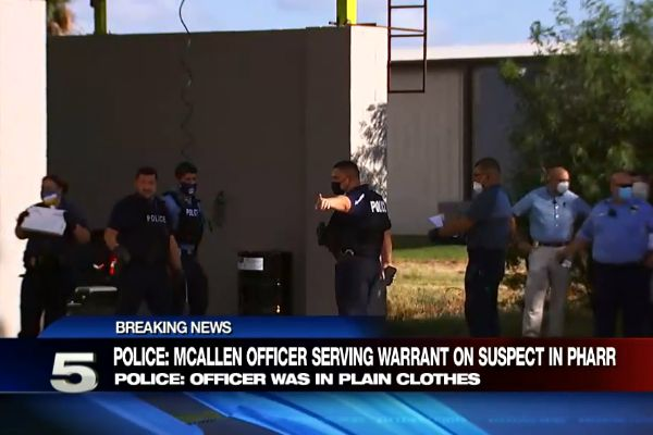 An officer with the McAllen (TX) Police Department was struck, pinned, and then dragged by a suspect in a vehicle as another officer opened fire on the assailant. - Screen grab of news report.