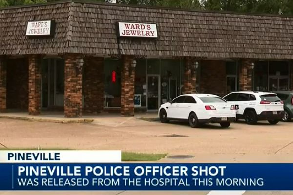 An officer with the Pineville (LA) Police Department who was ambushed and shot over the weekend has now been released from the hospital and is said to be recovering at home. - Screen grab of news report.
