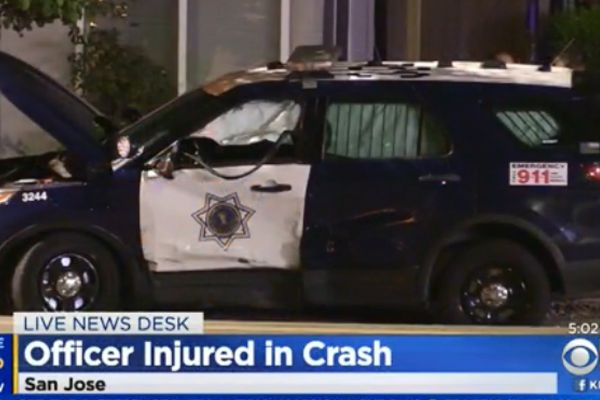 An officer with the San Jose (CA) Police Department was injured when a driver ran through a stop sign and slammed into his patrol car. - Screen grab of news report.