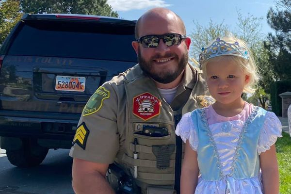 After a four-year-old girl was transported to a nearby hospital, the deputy—whose name has not been released—spoke with the family, learning that she was especially fond of Cinderella. He left, went to a local store, and purchased a Cinderella dress and crown for her. - Image courtesy ofRyan Meacham / Facebook.