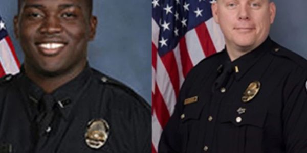 Officer Robinson Desroches, left, and Major Aubrey Gregory, right, of the Louisville Metro...