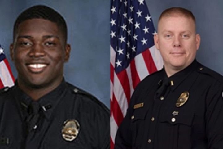 Officer Robinson Desroches, left, and Major Aubrey Gregory, right, of the Louisville Metro Police Department were shot and wounded Wednesday night. (Photo: LMPD) -