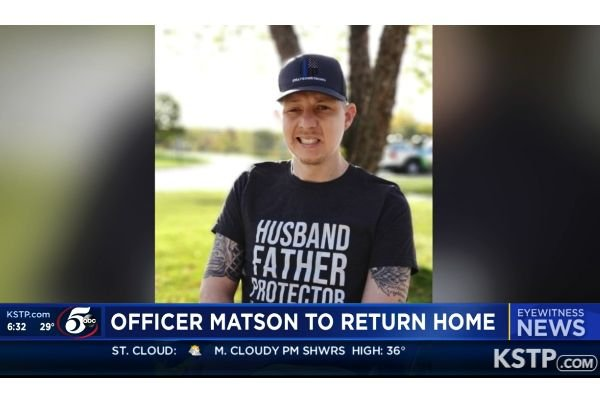 Officer Arik Matson has been undergoing treatment and rehabilitation at Nebraska medical facility sine being shot in the head in January. He now returns home to Minnesota.  - Screen grab of news report.
