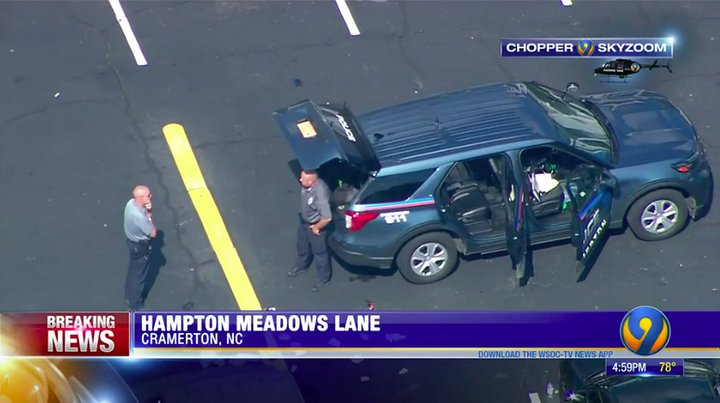 Police in Gaston County, NC, say a suspect was shot by a woman while he was in custody in the back of an SUV. (Photo: WSOC screen shot) -