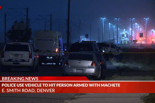 Officers with the Denver Police Department were forced to use at least one patrol vehicle to stop a rampaging assailant armed with a machete on Thursday morning. - Screen grab of news report.