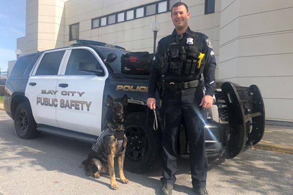 Officers with the Bay City (MI) Police Department are happy to welcome a new partner—K-9 Loki—to the ranks. - Image courtesy ofBay City Police Department / Facebook.