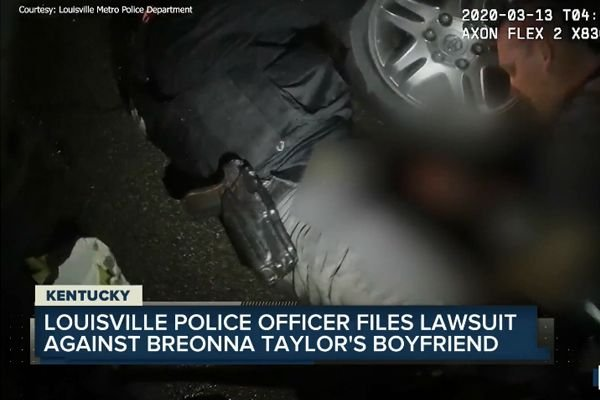 Sergeant Jonathan Mattingly says that he was shot in the thigh by Taylor's boyfriend—identified as Kenneth Walker—during the police search in Breonna Taylor's home. - Screen grab of news report.