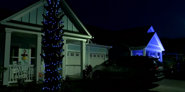 A Myrtle Beach, SC, neighborhood lit up blue Tuesday night to honor the local police and...