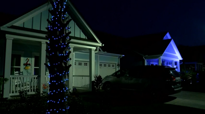 A Myrtle Beach, SC, neighborhood lit up blue Tuesday night to honor the local police and remember slain officer Jacob Hancher. (Photo: WMBF screen shot)  -