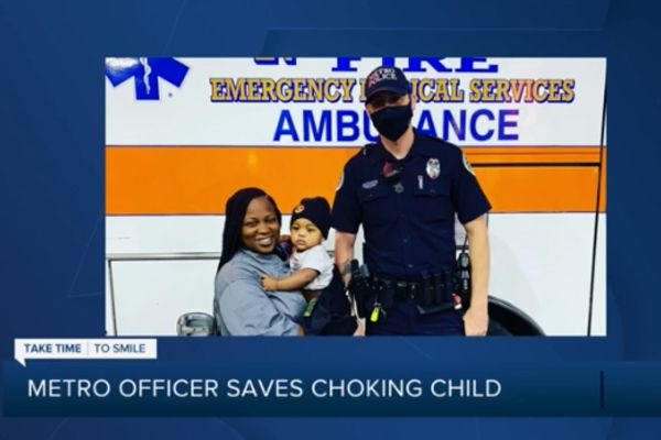 Officer Philip Claibourn was attending to another call for service when a woman frantically approached him with a small boy in her arms, apparently choking on something. - Screen grab of news report.