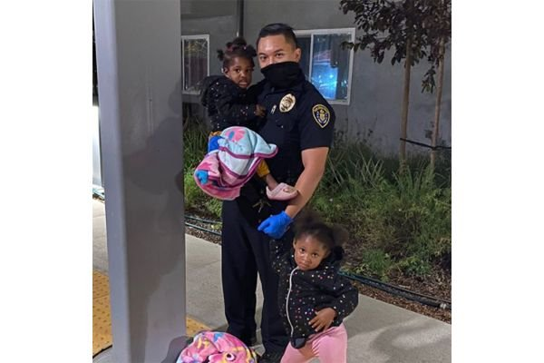The agency recently posted an image on its Instagram page of Officer Vital Adrianni, who volunteered to watch over two toddlers as a single dad handled a family emergency. - Image courtesy of San Diego PD / Instagram.