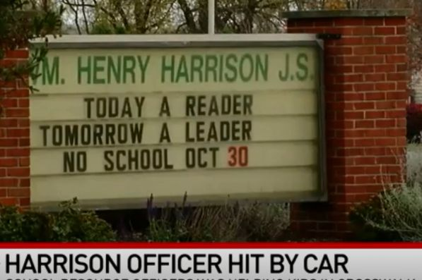 A school resource officer with the Harrison (OH) Police Department was struck by a vehicle as he was directing traffic in a crosswalk outside of a local junior high school on Wednesday. - Screen grab of news report.