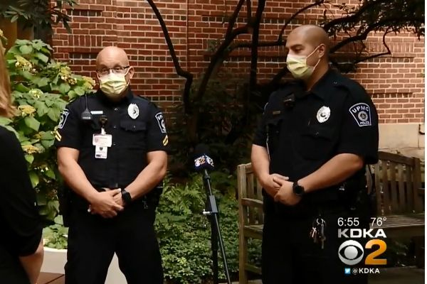 Officers Anthony Costa and Matthew Lisovich saved the life of a woman who was badly bleeding by applying a tourniquet and keeping her calm until other first responders were able to get to the scene. - Screen grab of news report.