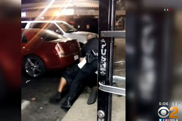 An officer with the San Bernardino (CA) Police Department reportedly shot a man who had produced a gun after the officer and the offender got into a scuffle outside a local liquor store late Thursday. - Screen grab of news report.