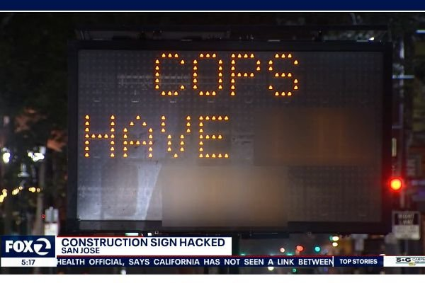 Clever computer hackers in California's Silicon Valley hijacked an electric road sign to display an anti-police message for passing motorists. - Screen grab of news report.
