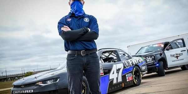 Nascar driver Kyle Weatherman drove the Fort Worth Police Officers Association Camaro in a...