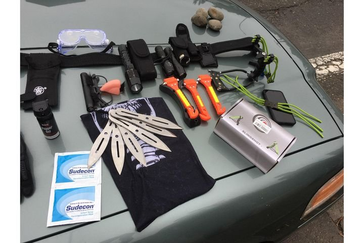 After a Portland officer was pepper sprayed in his patrol vehicle, responding officers say they found these weapons and gear in the suspect's car. (Photo: Portland Police Bureau) -