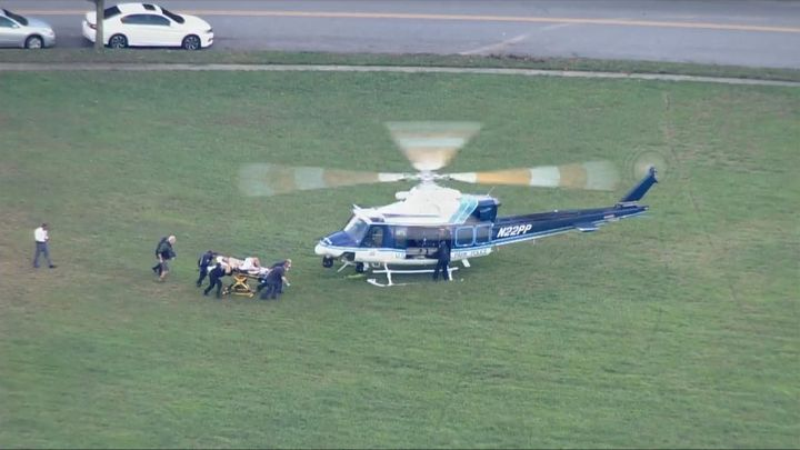 A Montgomery County, MD, police officer was airlifted from the scene after being shot during the attempted arrest of a homicide suspect. (Photo: ABC 7 Screen Shot) -