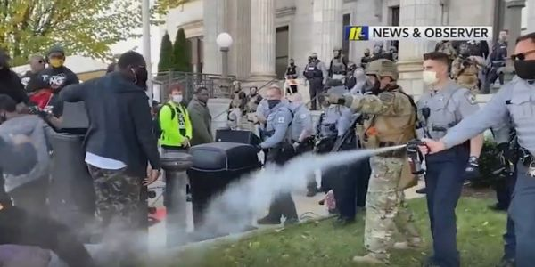 The suit accuses officers of excessive force when they pepper-sprayed the participants of a...