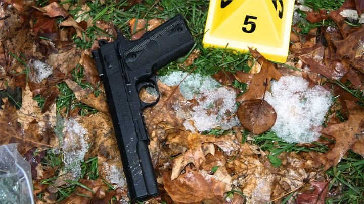 "Investigators said the pellet gun brandished by Rice was ""visually virtually indistinguishable from a real .45 Colt semiautomatic pistol."" (Photo: DOJ) -"