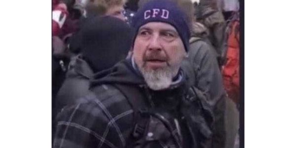 Federal authorities say this still from video taken at the Capitol riot shows Robert Sanford, a...