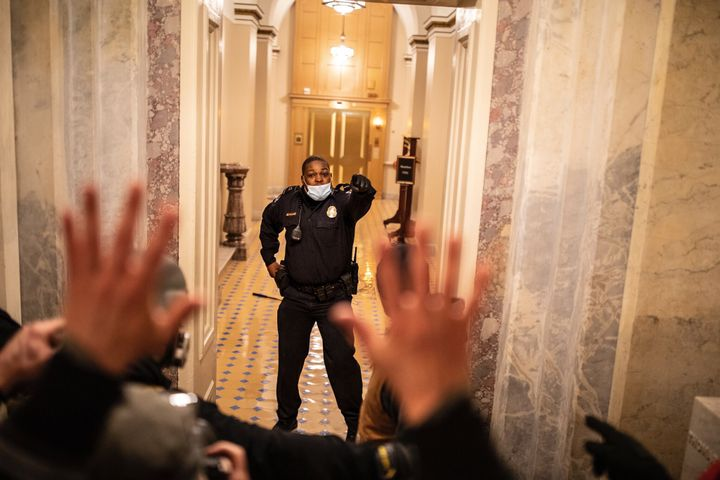 Capitol Police Officer Eugene Goodman delayed the mob and led them away from the Senate chambers. (Photo: Twitter Video) -