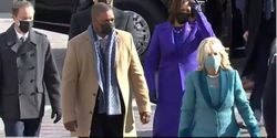 Capitol Police Officer Eugene Goodman (beige coat) escorts Vice President Kamala Harris and her husband to the inauguration ceremony. (Photo: Screen Shot from Washington Post Video)