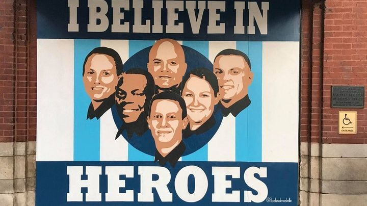 """The """"I Believe in Heroes"""" mural can be found on Second Avenue and Broadway, near Hard Rock Cafe. It's in the place of a window that was blown out when an RV exploded. (Photo: Fox17 Screen Shot) -"""