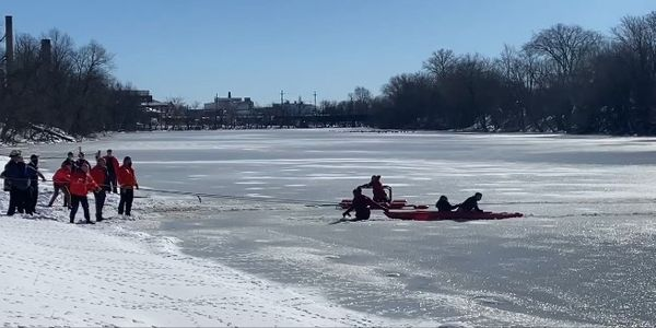 Chief Mike Foligno of the Elmwood Park Police Department and a firefighter used a kayak to pull...