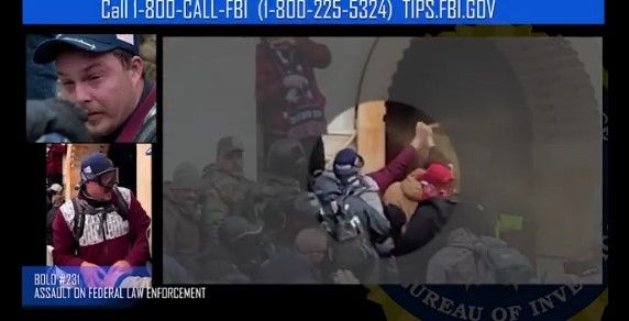 Screen shot from FBI video of attack on officers during Capitol riot. -