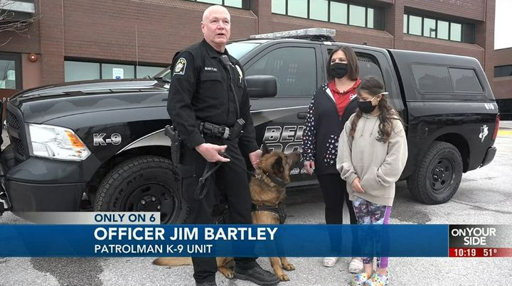 Officer Jim Brantley with11-year-old Izzy Greenfelder, her mother Brandi, and K-9 Max in his new body armor. (Photo: News 6 Screen Shot) -