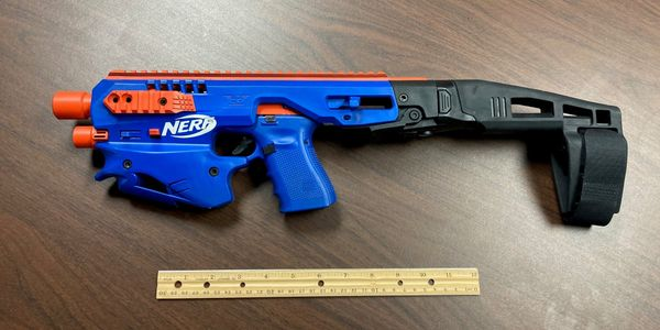This modified Nerf gun housing a Glock 19 pistol was found during a North Carolina drug raid....