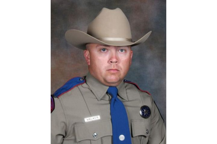 """""""Before Trooper Chad Walker could stop his patrol unit (the suspect) immediately emerged from the driver's seat of the disabled vehicle armed with a handgun and fired multiple rounds,"""" Texas Department of Public Safety Officers Association said. (Photo: Texas DPS/Facebook) -"""