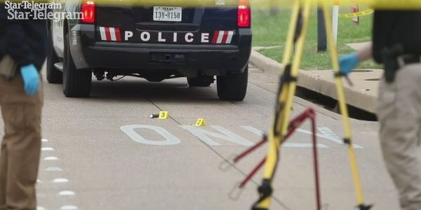 TX Officer Shot at Traffic Stop, Suspects at Large