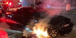 An NYPD officer's personal vehicle burns outside of a Coney Island subway station. (Photo: PBA)