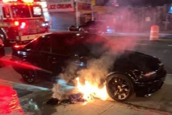 An NYPD officer's personal vehicle burns outside of a Coney Island subway station. (Photo: PBA) -