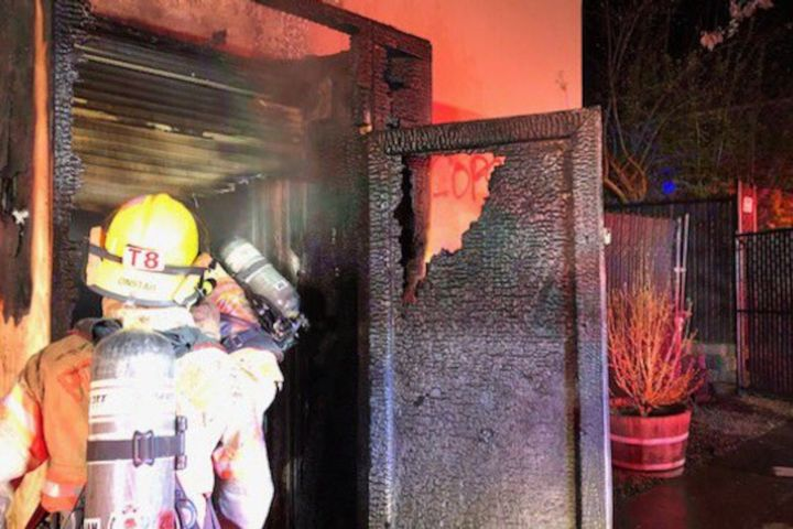 Portland firefighters inspect the damage caused to the police union building Tuesday night. (Photo: Portland Police Bureau) -