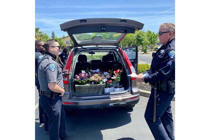 After arresting a delivery for DUI on Mother's Day, officers from the Fairfield (CA) Police Department made sure the flowers got to their intended recipients. (Photo: Fairfield PD/Facebook) -