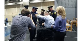 Houston Officer Paralyzed in Shooting Pins His Badge on His Son at Graduation
