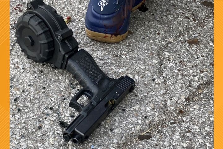 Indianapolis police recovered this pistol at the scene of a shooting where an officer was wounded Saturday. (Photo: IMPD) -