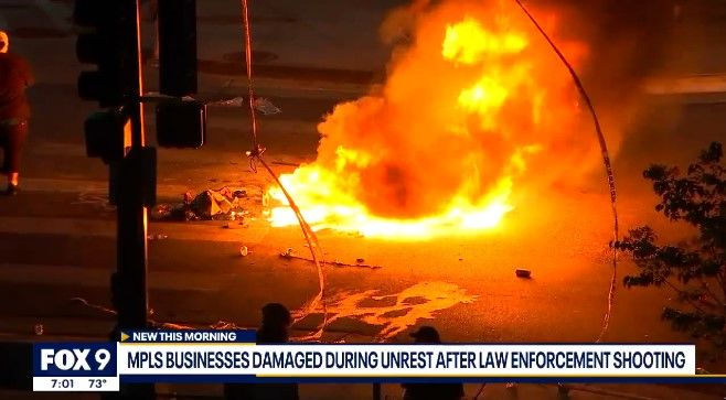 Fires were set in Minneapolis Thursday night after an armed fugitive was killed by officers working in a U.S. Marshals task force. (Photo: Fox 9) -