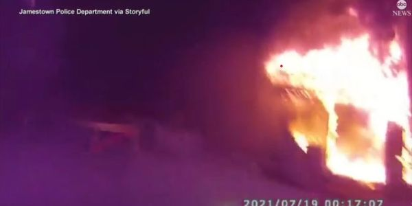 NY Officer Catches People Jumping from Second Floor of Burning Home